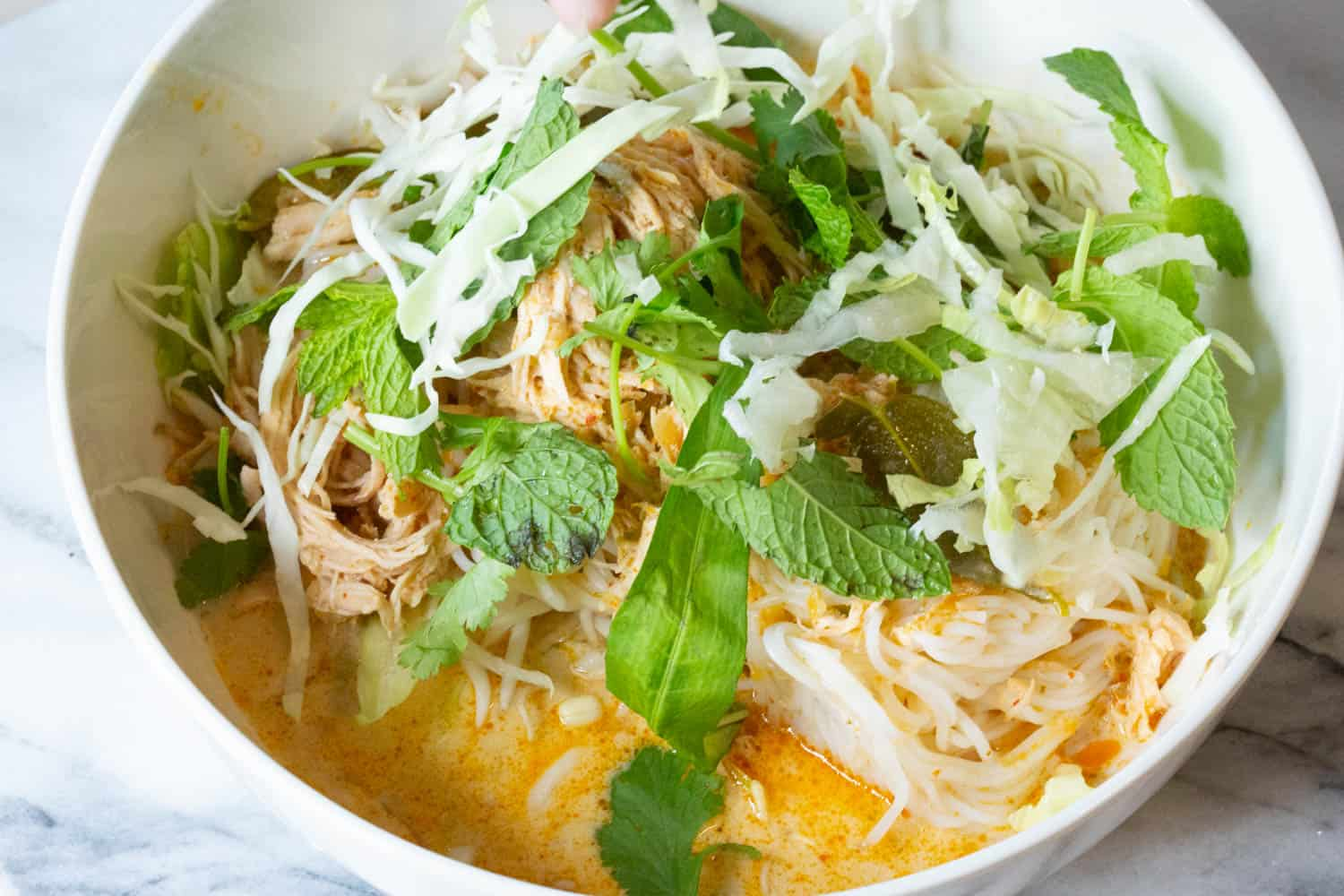 khao poon lao red curry noodle in a bowl