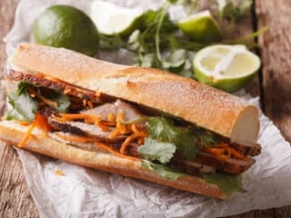 pickled carrots and daikon on banh mi sandwich