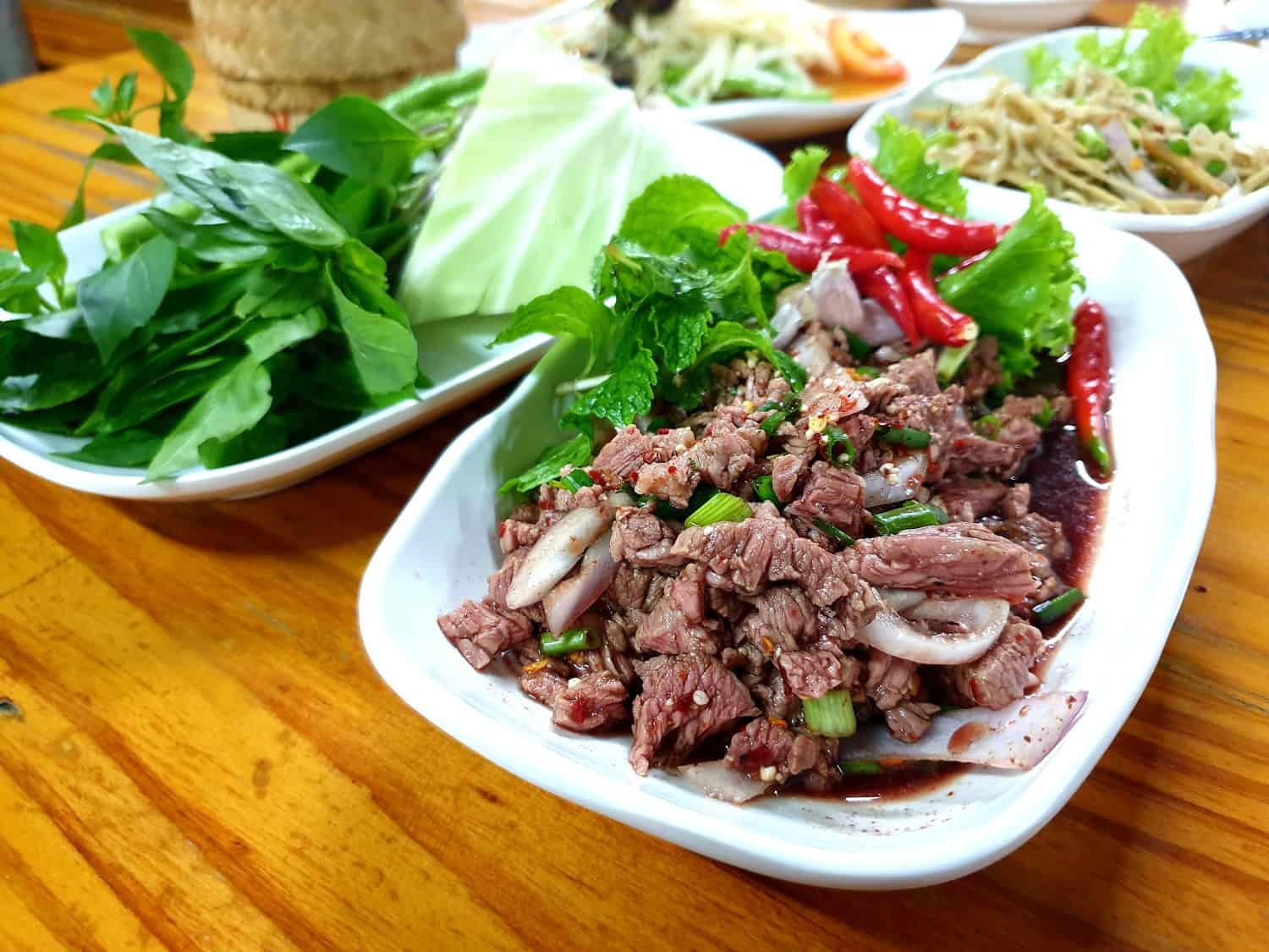 larb vs nam tok minced meat salad comparison