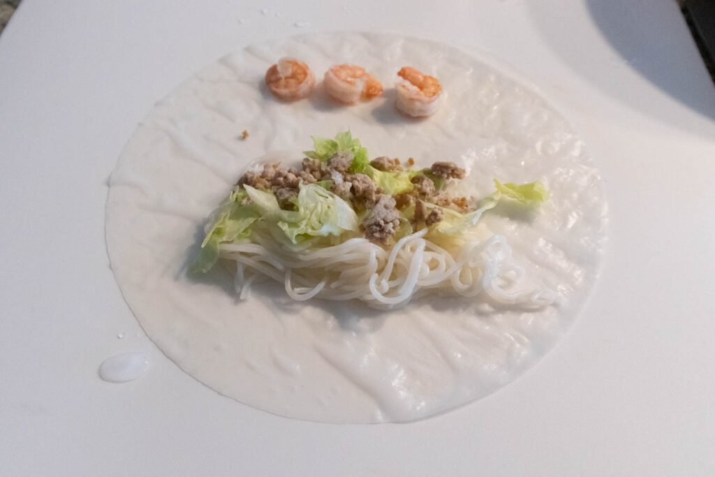 making Vietnamese summer rolls with preparing station